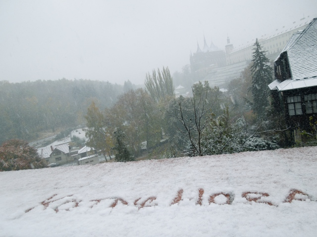 Australian Guy wrote Kutna Hora in the snow with his finger.