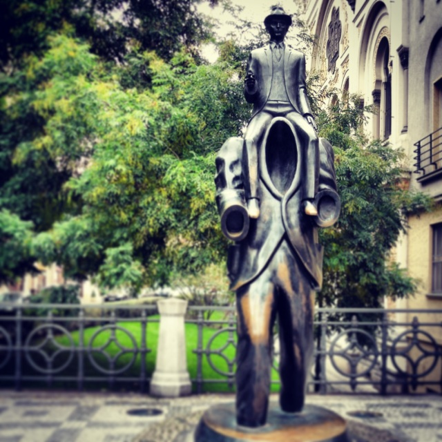 Memorial to Franz Kafka by sculptor Jaroslav Rona, located in the historic Jewish Quarter, where Kafka spent most of his life, and where many of his stories take place.