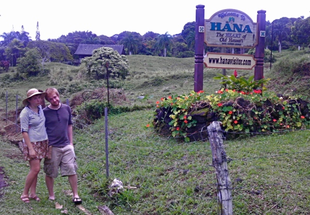 """E and I posing by the """"Welcome to Hana"""" sign."""