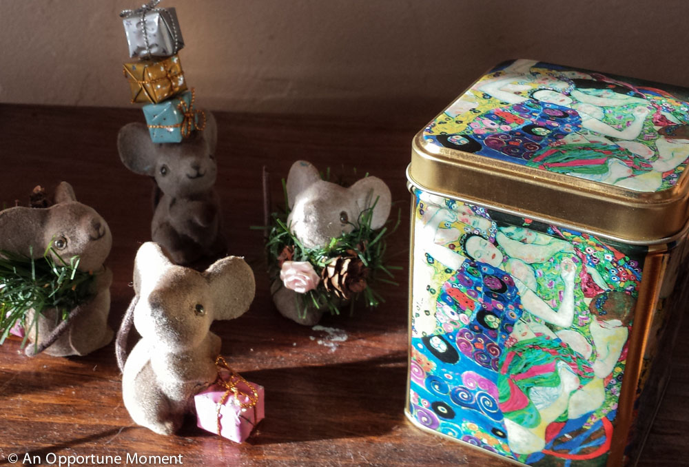 Tea tin pictured here beside some of my many Christmas knick-knacks