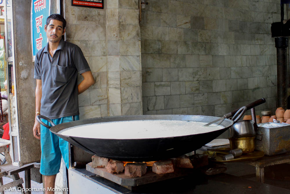 This man looks so forlorn about his huge pan of lassi