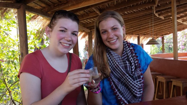 Kristen and I sampling cashew apple liqueurs in Warang